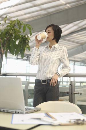 Woman enjoying a cup of coffee Stock Photo - 4630827