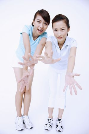 Two young women posing for the camera Stock Photo