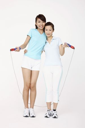 bonding rope: Two young women posing with skipping rope