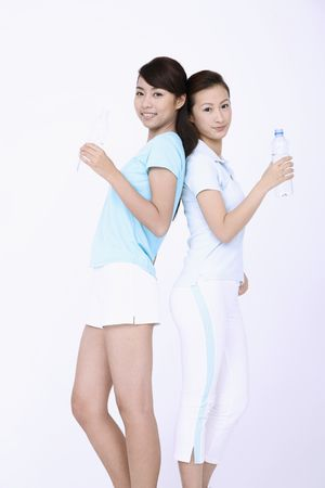 Young women holding water bottles