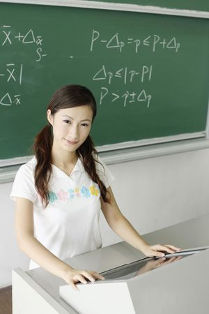 Young woman using computer photo