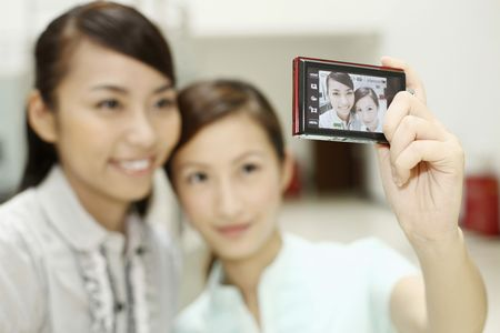 Young women taking picture together Stock Photo - 4630899