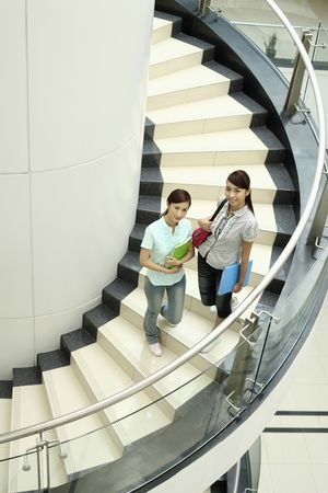 Young women posing at the staircase