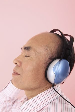 Senior man listening to headphones Stock Photo - 4636336