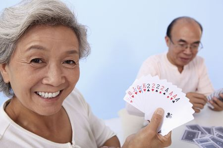 Senior woman showing her cards photo