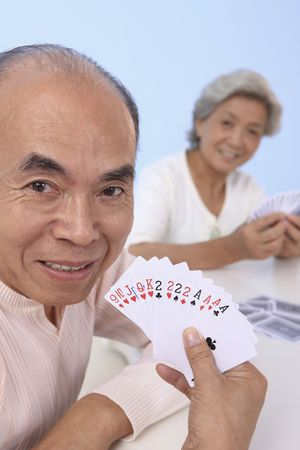 Senior man showing his cards Stock Photo - 4635974