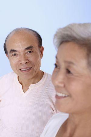 Senior man smiling at camera photo