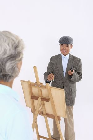 Senior man painting senior woman's portrait Stock Photo - 4636212