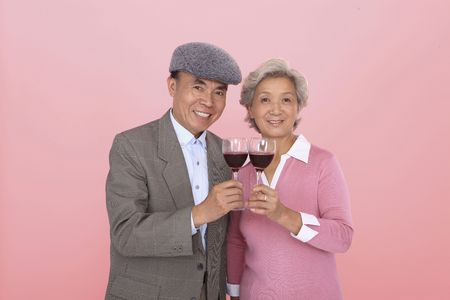 Senior man and senior woman with wine photo