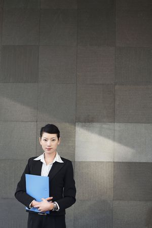 Businesswoman holding file photo