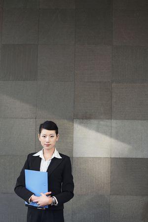 Businesswoman holding file Stock Photo