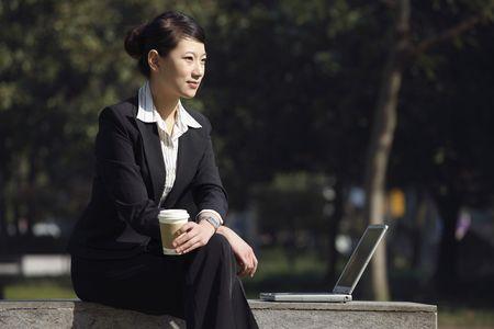 Businesswoman taking a break in the park Stock Photo - 4636497