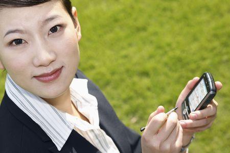 Businesswoman using pda photo