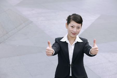 Businesswoman showing two thumbs up photo