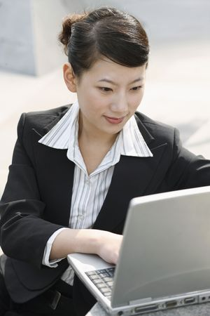 Businesswoman using laptop Stock Photo - 4635996