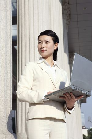 Businesswoman holding laptop Stock Photo - 4636433