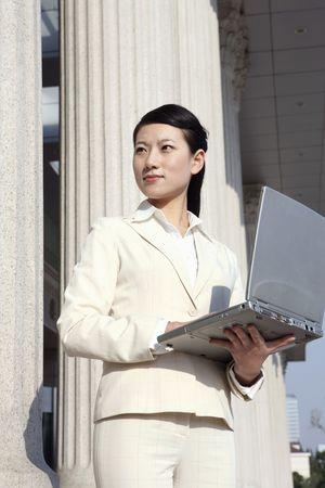 Businesswoman holding laptop Stock Photo - 4636433