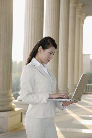 Businesswoman using laptop photo