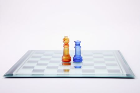 Glass chess set with King and Queen chess pieces photo