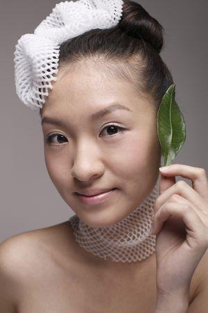 Woman wearing foam net accessories holding leaf Stock Photo - 4653990