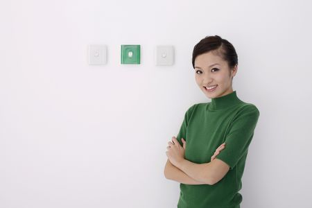 switches: Woman standing beside light switches