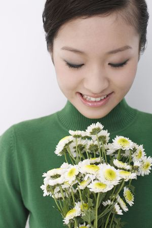 Woman looking at flowers Stock Photo - 4653853