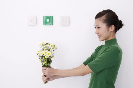Woman holding flowers Stock Photo - 4654009