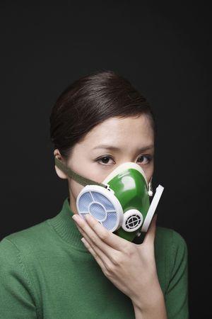 Woman wearing gas mask photo