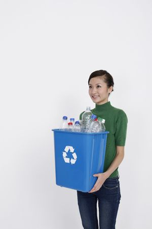 Woman holding recycling bin with plastic bottles in it Stock Photo - 4653805