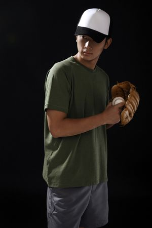 Man with baseball and baseball glove