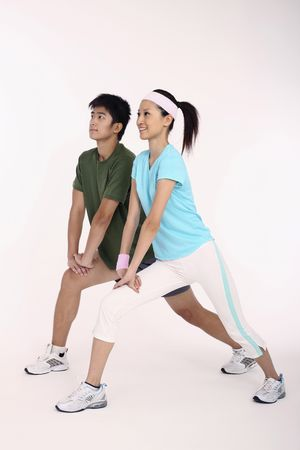 Man and woman exercising Stock Photo