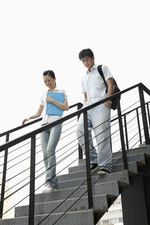 Man and woman walking down the stairs photo