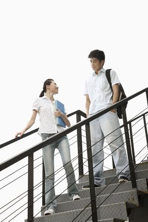 young adult man: Man and woman chatting