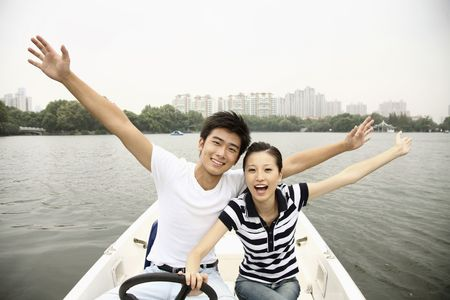 Man and woman having fun traveling on the boat photo