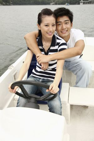 Man and woman traveling on the boat photo