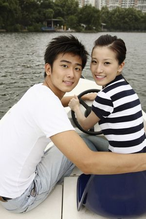 Man and woman traveling on the boat, smiling Stock Photo - 10295793