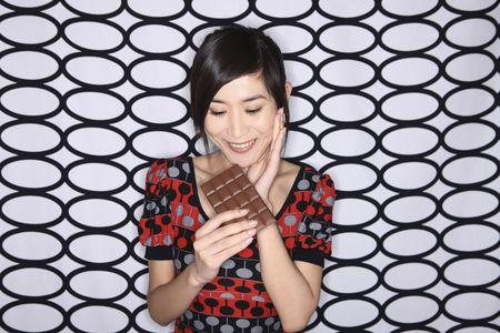 Woman holding chocolate bar photo