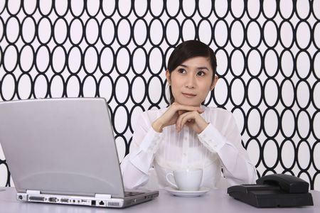 Businesswoman contemplating at her desk photo