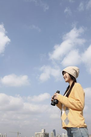Woman using binoculars photo