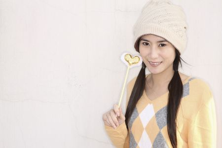 Woman holding magic wand photo