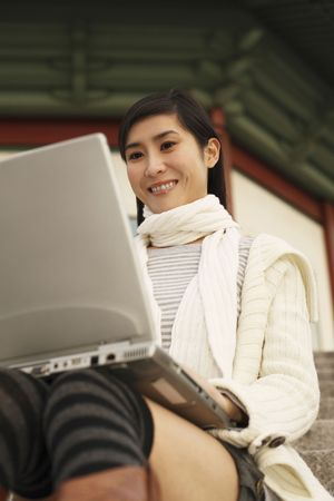 Woman using laptop Stock Photo