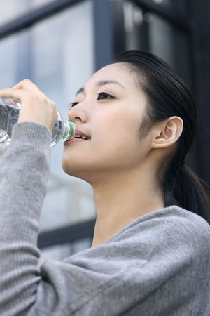 Woman drinking water Stock Photo - 10296306