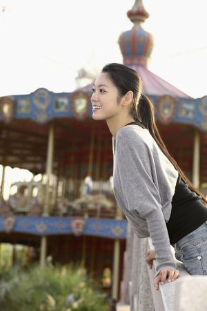 Woman enjoying herself at amusement park