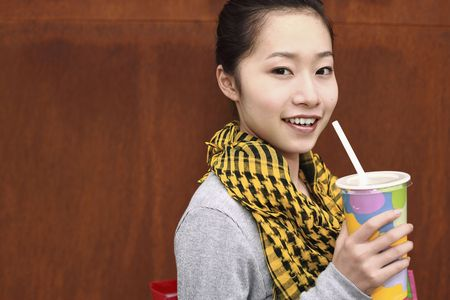 Woman with a cup of drink Stock Photo