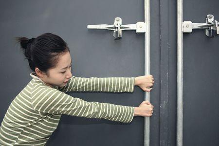 Woman trying to open door photo