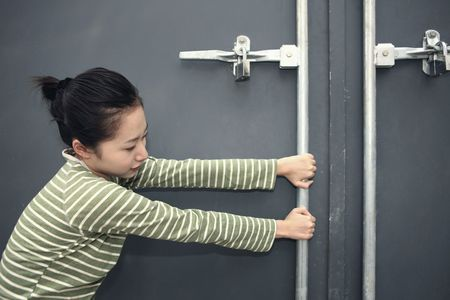 Woman trying to open door Stock Photo