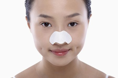 pore: Young woman with pore strips on her nose Stock Photo