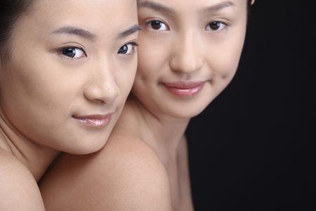 Two beautiful young women posing together photo