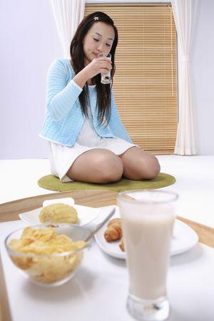 Young woman enjoying a glass of milk photo