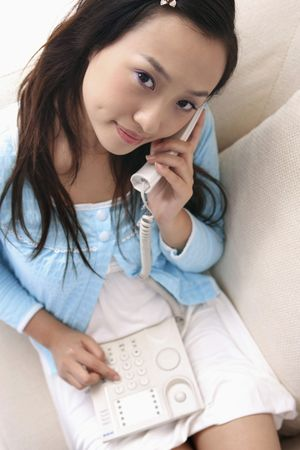 Young woman making a telephone call photo
